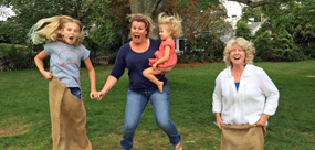 Family jumping in potato sack race