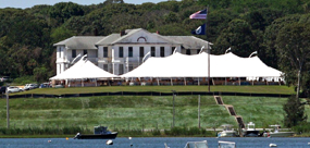 MV Museum from the lagoon with tents on the lawn