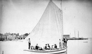 Men on boat under sail