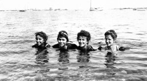 Four women in the ocean