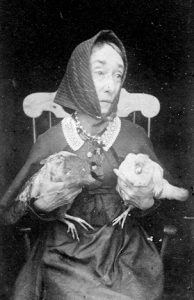 Nancy Luce with chickens