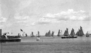 Historic panorama of harbor with ships under sail