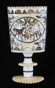 Ornate scrimshaw cup with birds