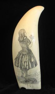 Scrimshaw featuring woman holding a flower