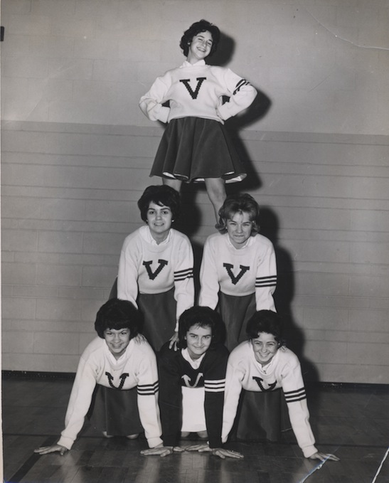 Mid-century cheerleaders in pyramid formation
