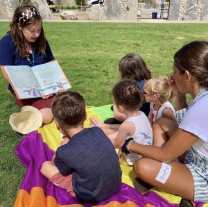 Teacher with students on the museum lawn for Discovery Days program