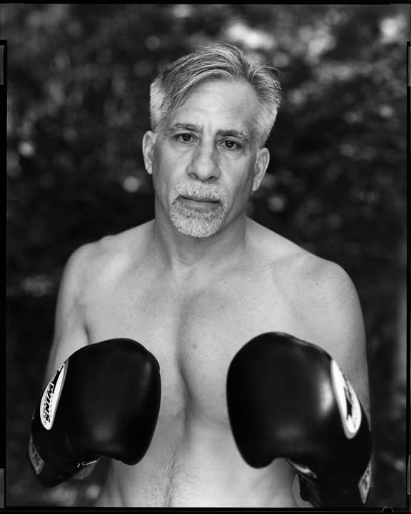 Photo portrait of Charles Giordano with boxing gloves