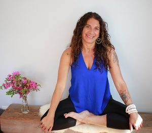 Sherry Sidoti sitting in lotus position