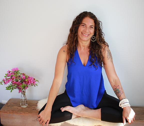 Sherry Sidoti sitting in lotus position